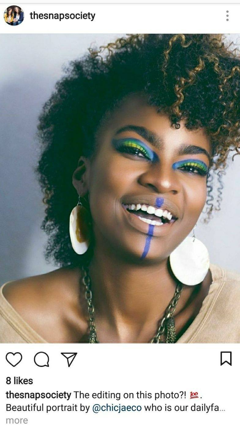 Portrait by Chic Jae of a woman laughing with eclectic makeup featured on snap society